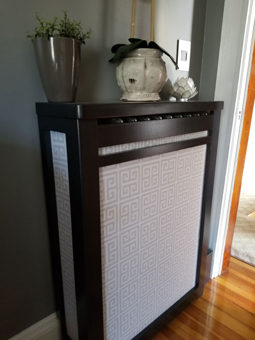 Dark wood radiator cover with light fabric cover