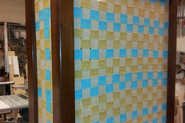 dark wood frame radiator cover with green and blue checkered fabric