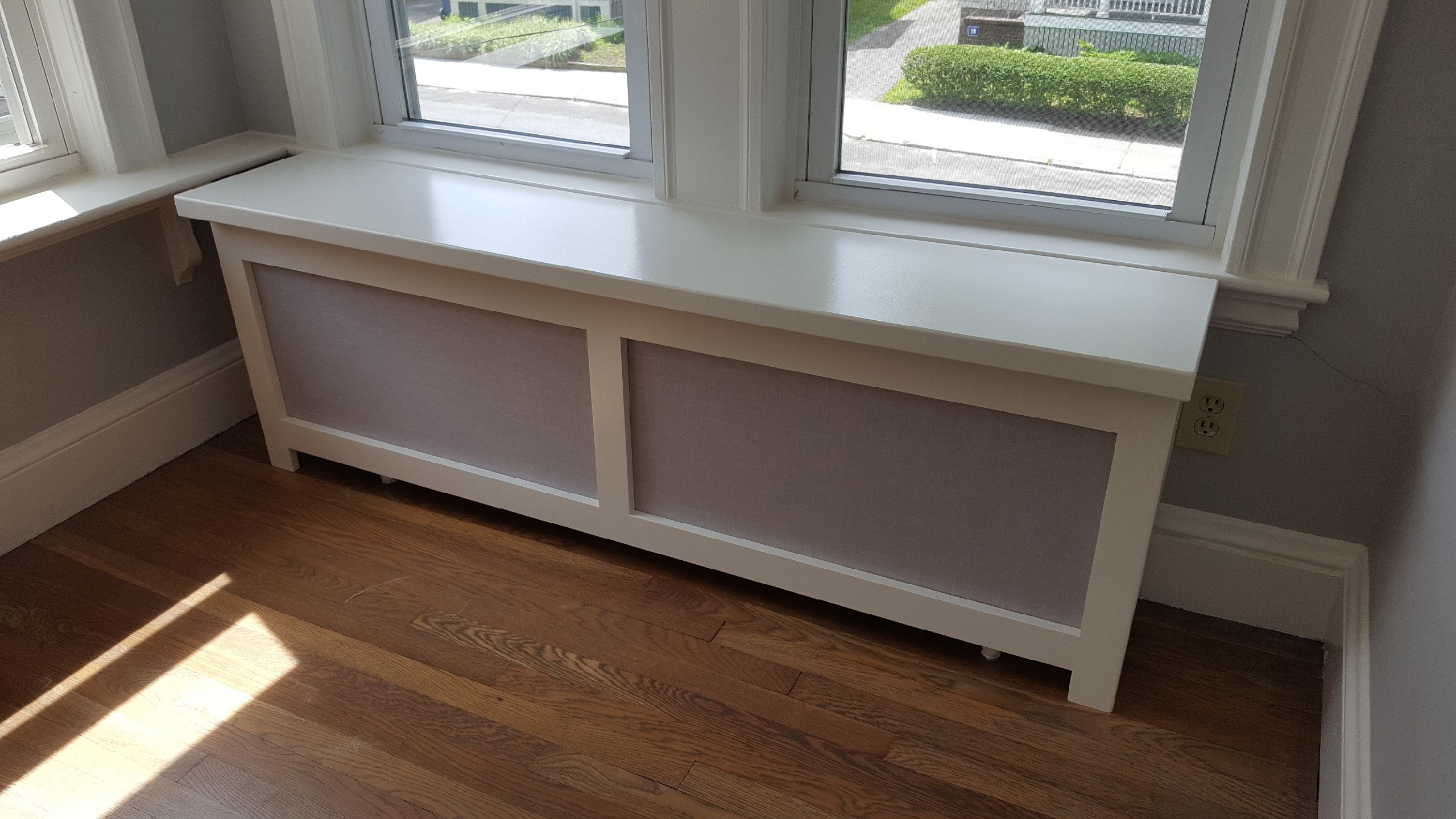 Long white radiator cover with fabric panels