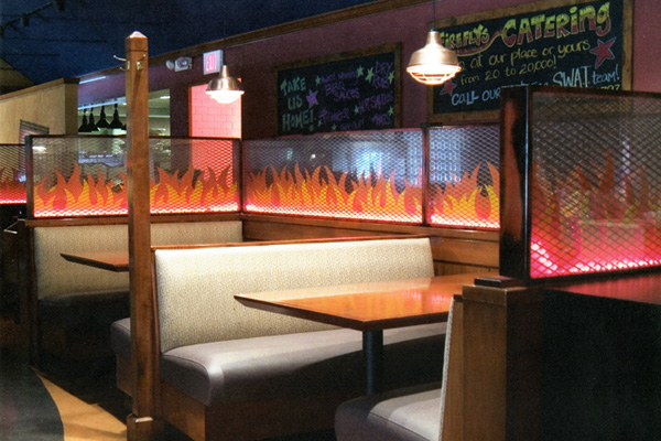 restaurant booths with fire shaped detail work along sides